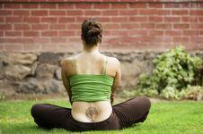 Free Woman With A Tattoo On Her Back Stock Images - 5841814