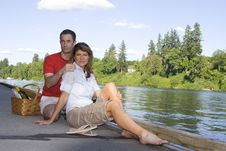 Free Couple Having A Picnic By The Lake - Horizontal Stock Photography - 5842152