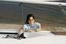 Free Woman Fixing Something On Boat - Horizontal Stock Photography - 5842192
