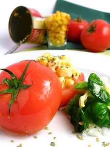 Tomato Stuffed With Corn Stock Images