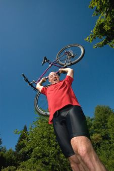Free Man Lifting Bicycle Over Head - Vertical Stock Photo - 5842220