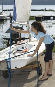 Free Woman Fixing Sail On Sailboat - Vertical Stock Photography - 5842682