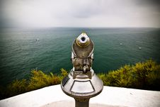 Monocular Pointing To The Sea Royalty Free Stock Image