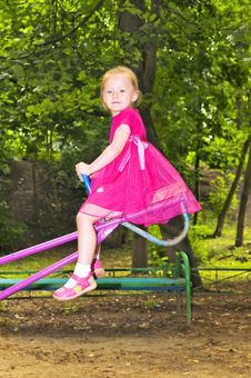Free Cute Girl On Swings Royalty Free Stock Images - 5845049