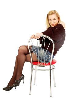 Free Posing Girl Sits On A Chair Holding Its Back Stock Images - 5845284