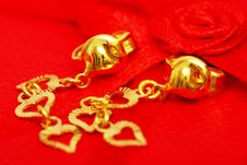 Free Earring And The Red Rose Ribbon Royalty Free Stock Photo - 5846015