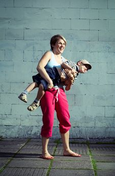 Free Mother Holding Her Son. Royalty Free Stock Photos - 5846318