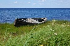 Old Fishing Black Boat On The Lake Bank Royalty Free Stock Photo