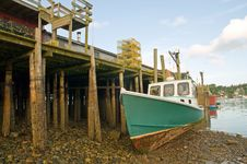 Boat Aground At Wharf Stock Images