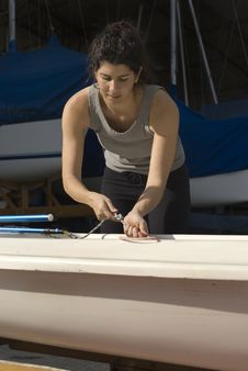 Woman Getting Ready To Sail - Vertical Royalty Free Stock Images