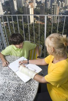 Free Woman Teaching Boy - Vertical Stock Photo - 5850250