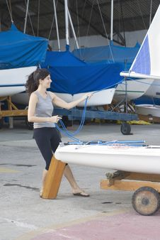 Free Woman Tightening Sail Rigging - Vertical Royalty Free Stock Images - 5850319