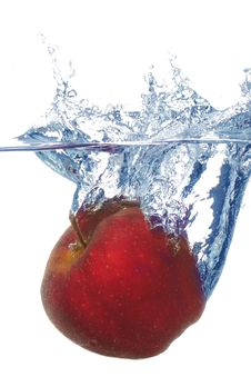Splashing Apple Into A Water Royalty Free Stock Photo
