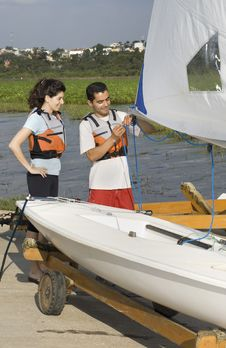 Free Man Teaching Woman To Sail On Land - Vertical Stock Photos - 5850703