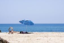 Free Man Reading In The Beach Stock Photography - 5851592