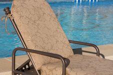 Free Patio Chair Next To An Aqua Blue Pool Royalty Free Stock Photo - 5852115