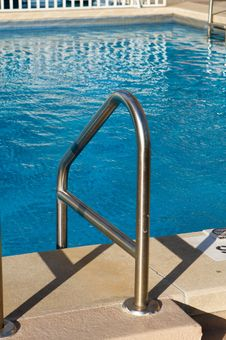 Free A Ladder Leading Into A Bright Blue Pool Stock Photos - 5852343