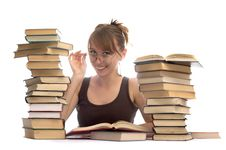 Young Woman And A Pile Of Books Royalty Free Stock Photo
