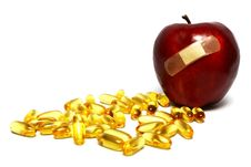 Apple And Capsules Royalty Free Stock Images