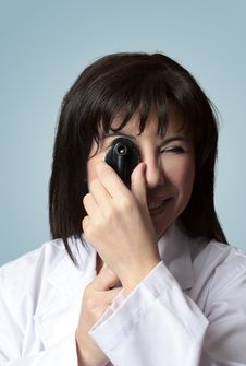 Free Eye Doctor Using Opthalmoscope Royalty Free Stock Photo - 5853605