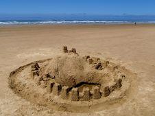 Sand Castle On Ocean Beach Stock Photo