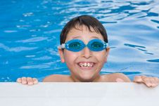 Free Boy Swimming In The Pool With Goggles Royalty Free Stock Photography - 5856657