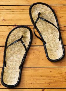 Free Sandals On Wooden Floor Stock Image - 5858151