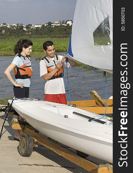Man Teaching Woman to Sail on Land - Vertical