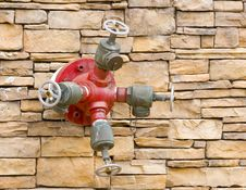 Free Fire Hydrant On Rock Wqll Royalty Free Stock Photography - 5861057
