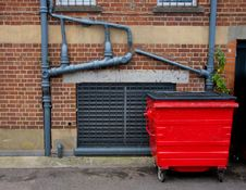 Free Red Garbage Bin And Outside Sewer Pipes Stock Images - 5863054