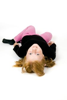 Free Little Girl Is Laying On Floor Stock Photos - 5863813