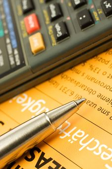 Calculator Over Orange Paper Royalty Free Stock Images