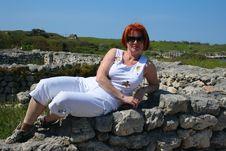 Free Woman On Stone Wall Stock Photos - 5866313