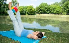 Free Girl Enjoying Some Exercises With Ball Outdoors Stock Photography - 5868592