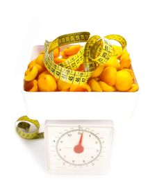 Sweet Apricots And Tape Measure Royalty Free Stock Image