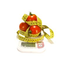 Free Juicy Tomatos And Tape Measure Royalty Free Stock Images - 5872959