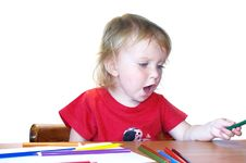 Cute Girl And Color Pencils Stock Photos