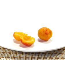 Apricots On A White Plate Stock Image