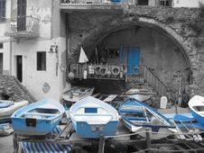Blue Boats In Riomaggiore Harbour Royalty Free Stock Images