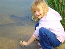 Free Little Girl On The Riverside. Royalty Free Stock Images - 5875149