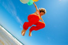 Free Girl With Colorful Balloons Jumping Royalty Free Stock Photos - 5878448