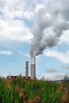 Smoke Billowing Out Of A Smoke Stack Stock Images