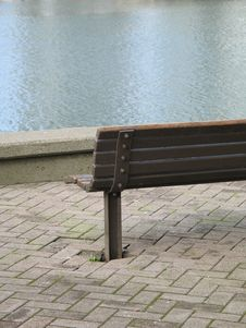 Park Bench By The Water Royalty Free Stock Photos