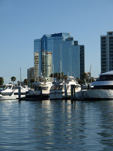 Luxury Glass Hotel With Yachts In Harbor Stock Images