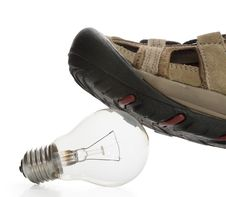 Man Shoe Steeping And Crushing The Bulb, Side View Stock Photos