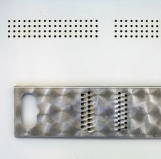 Free Grater On A Metallic Sheet Royalty Free Stock Images - 5883099
