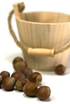 Hazelnuts And Wooden Basket Stock Photo