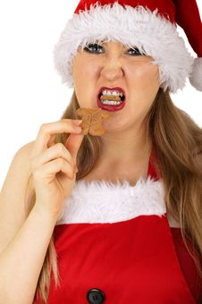 Mrs Santa Angry At Gingerbread Stock Photo