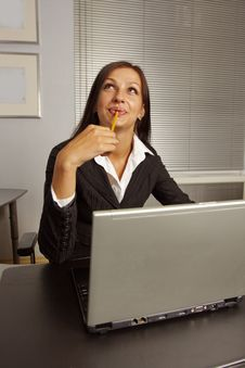 Free Businesswoman Sitting In Office Stock Image - 5886381