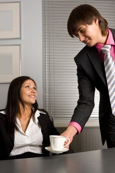 Young Successful Businessman Giving A Cup Of Coffe Stock Images